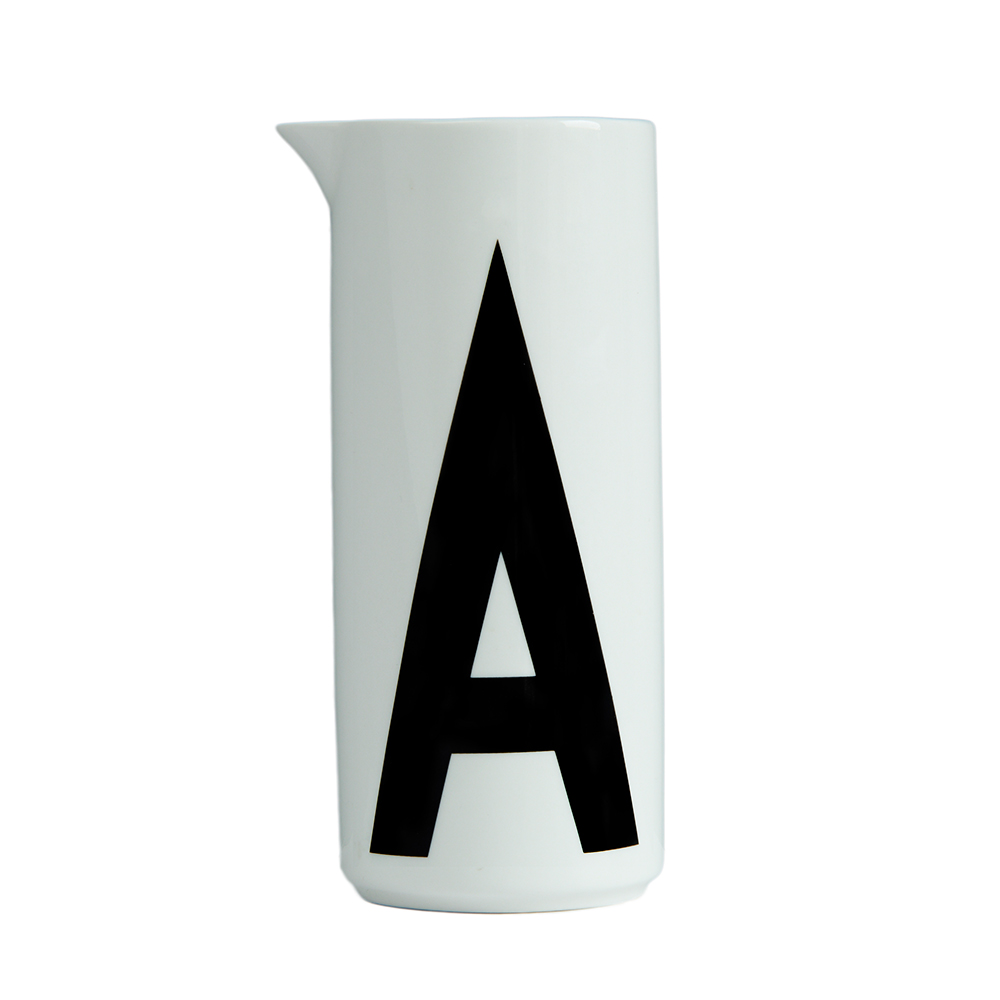 A water pitcher featuring Arne Jacobsen's vintage ABC and numbers by Design Letters